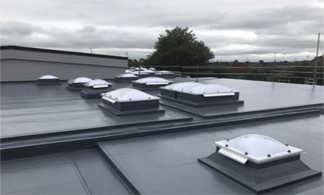 Roof covered with a hot melt system coating